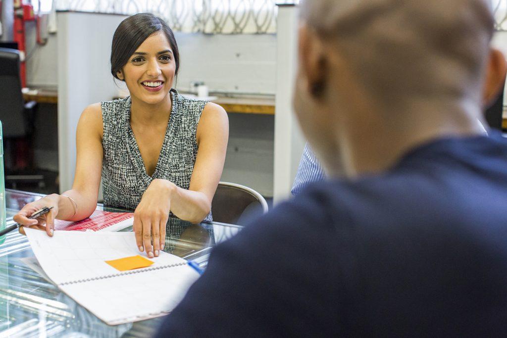 Smiling people talking in meeting
